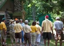 A group touring the James Tellen Woodland Sculpture Garden.